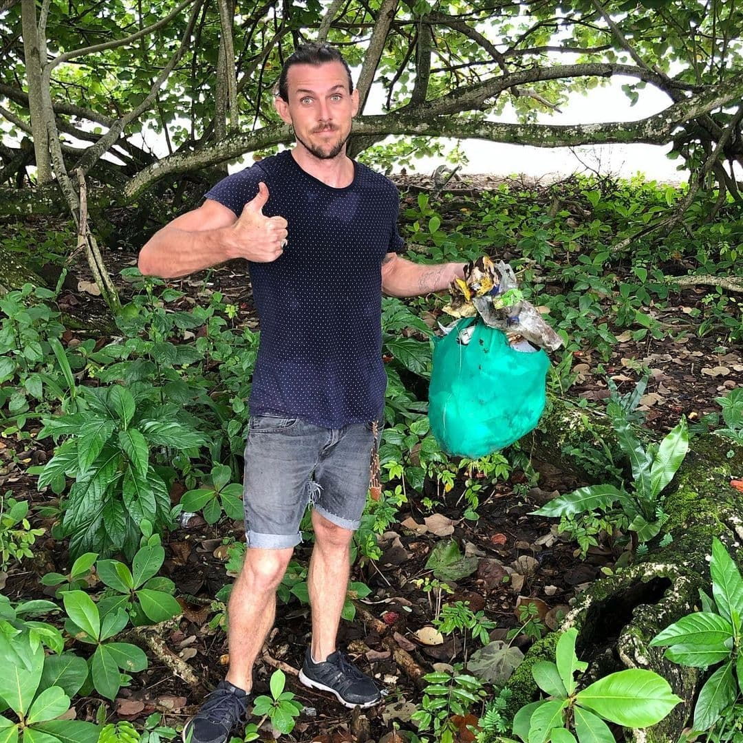 Tom Wright is giving the thumbs up as he poses with a bag of rubbish he picked up on Isla Colon, Bocas del Toro, Panama