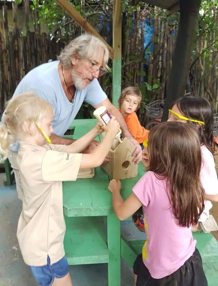 Joe Riccardi teaching the children of Tangerine school how to make bird houses.