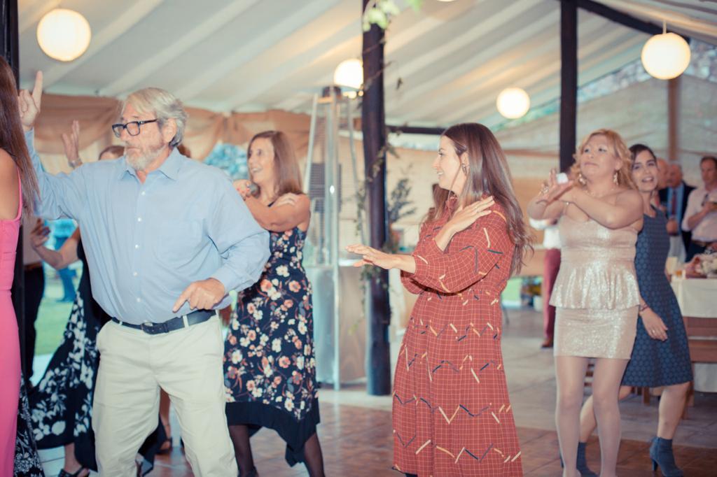 Joe Riccardi doing the macarena at a wedding in peru