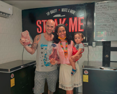 Cliff poses with Dayana and Aiden in their new meat store Sabroso Meats in Bocas del Toro Panama