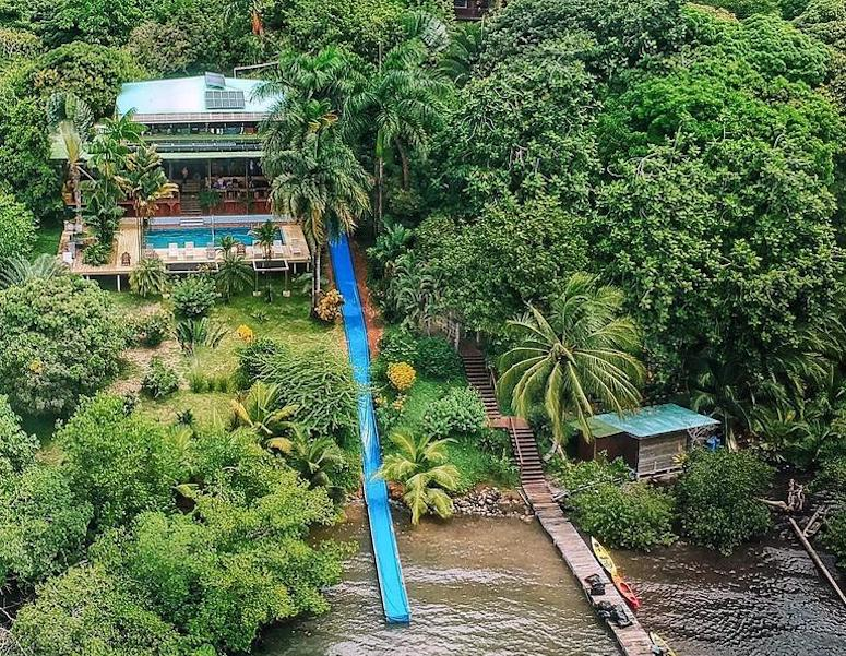 Drone shot of Bambuda Lodge and its 150 foot waterslide on Isla Solarte, Bocas del Toro, Panama. The bloggers Our Escape Clause neglected to find out about this water slide.