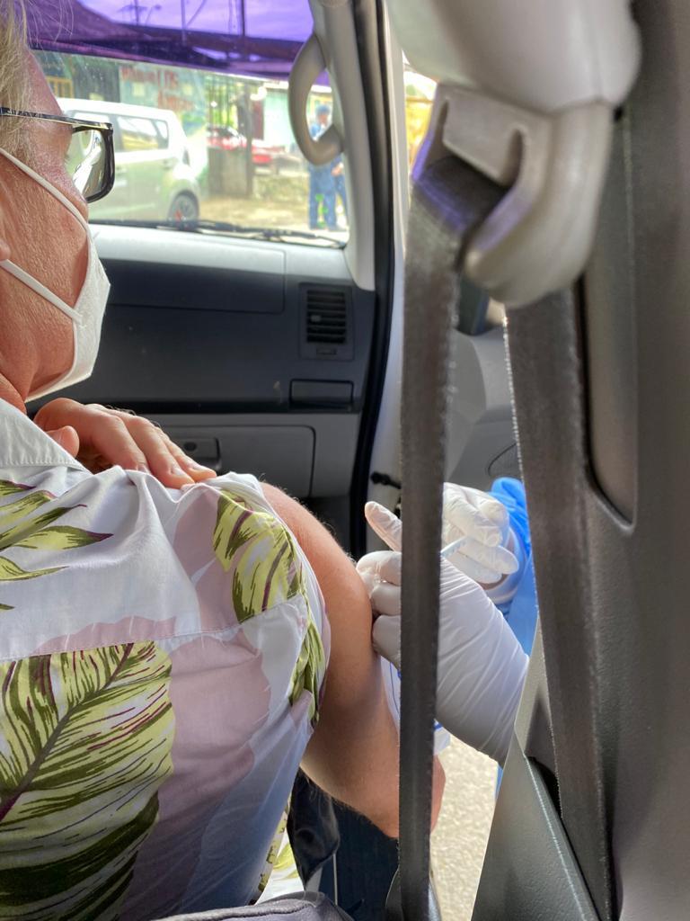 A man receiving his COVID-19 vaccine through a car door in Changuinola