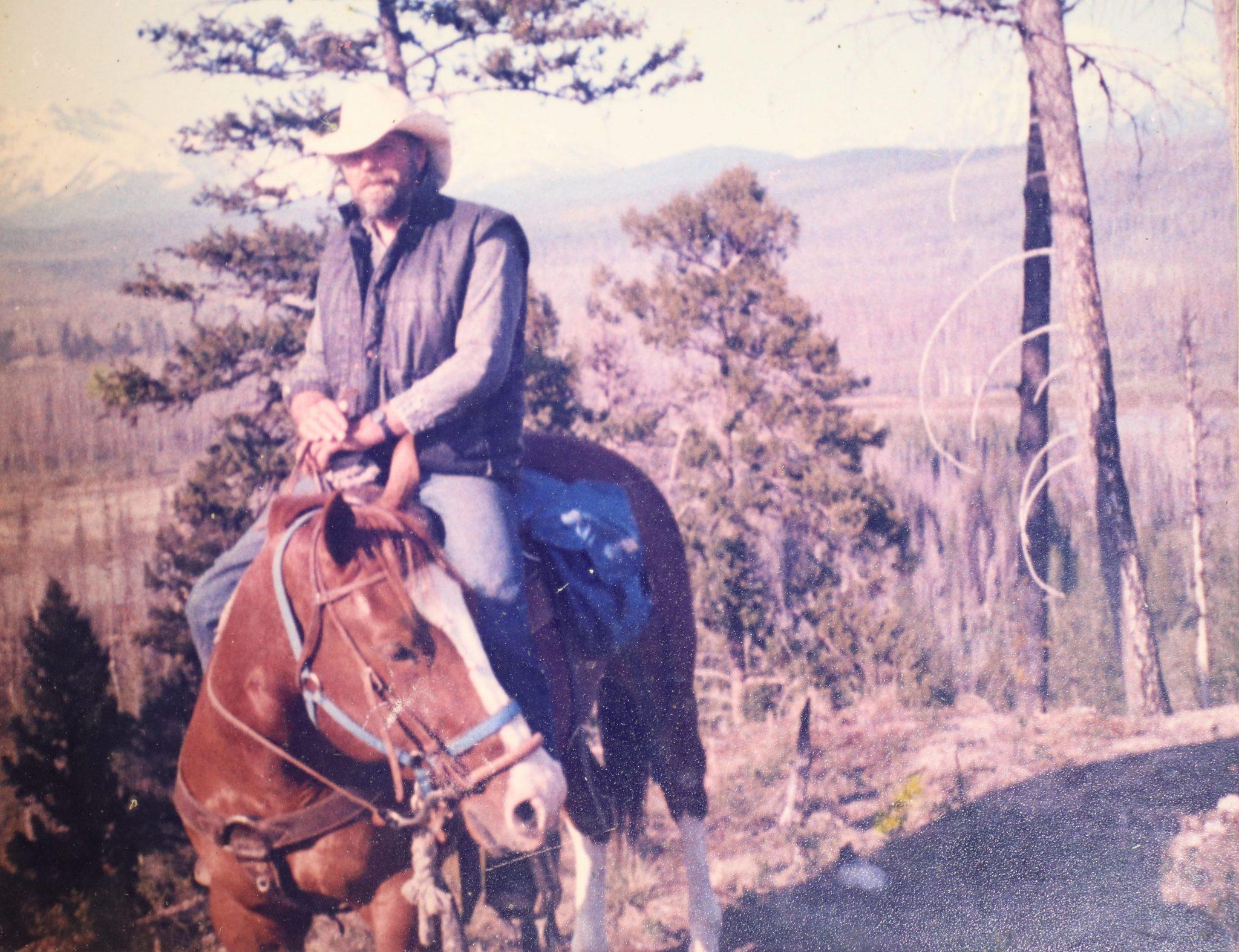 Young Tim Sullivan wearing a cowboy hat, riding horseback.