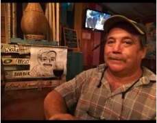 Jeff posing with the portrait made by his favorite waitress Celeste