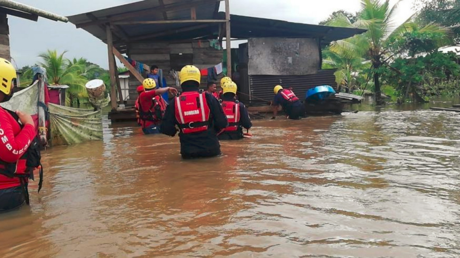 Rescue team helping people evacuated a flooded home in Panama