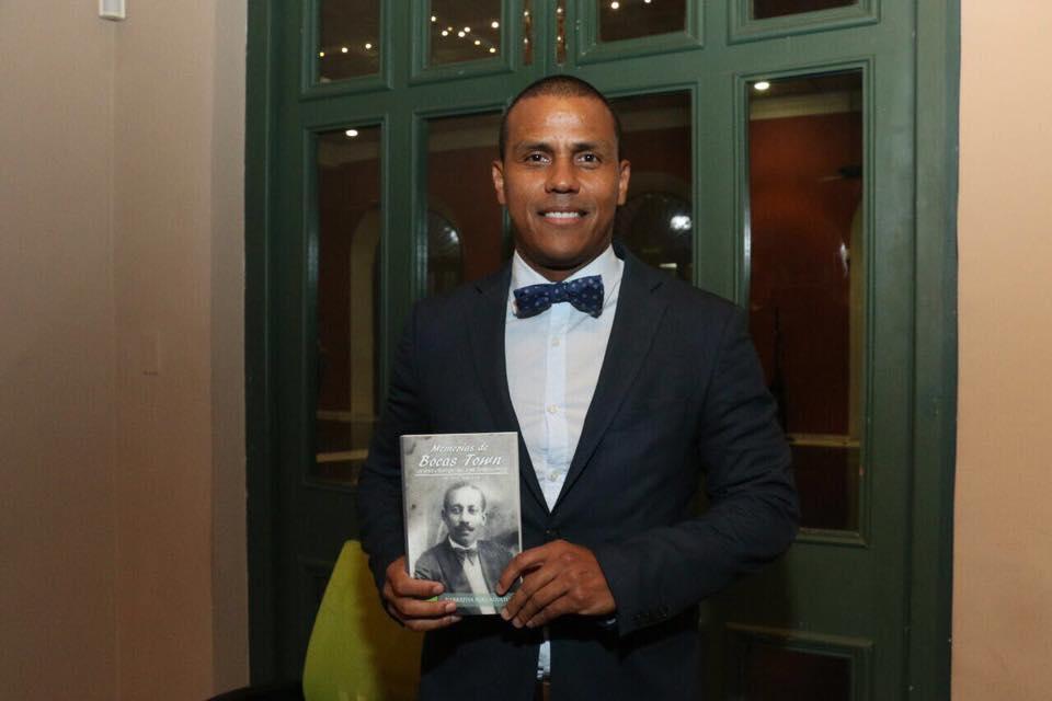Author Ariel Perez Price and the first edition of Memorias de Bocas Town: La Vida y Tiempo de Jose Antonio Price