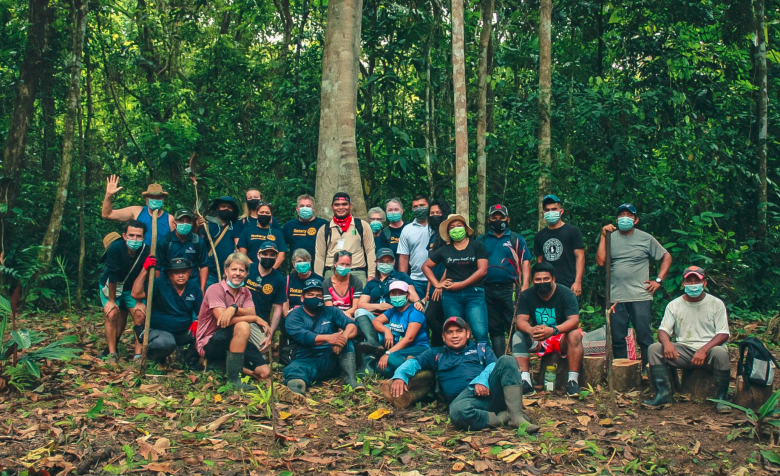a group photo of volunteers at a tree planting ceremony for the group Bocas Rainforest Reforestation Initiative