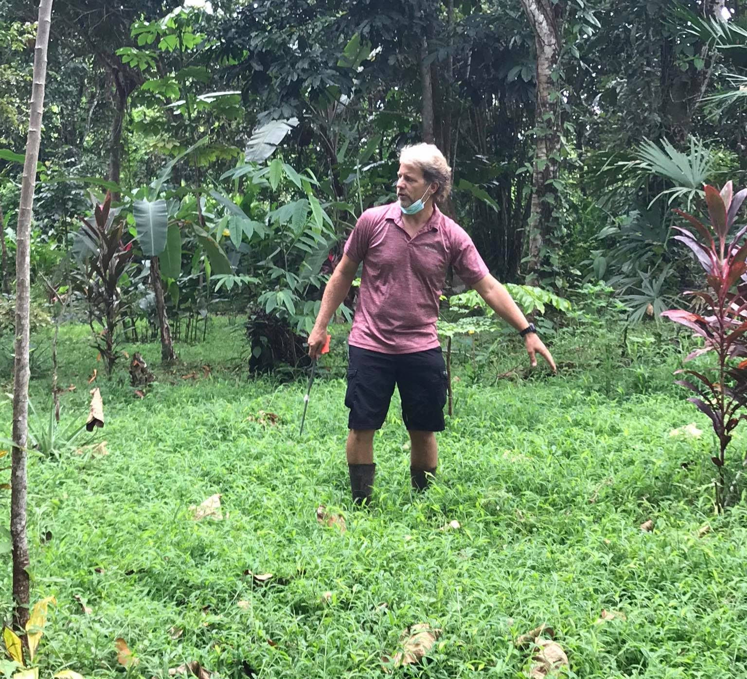 Brian Wilcox of Bocas Rainforest Reforestation Institute explaining to volunteers their reforestation project