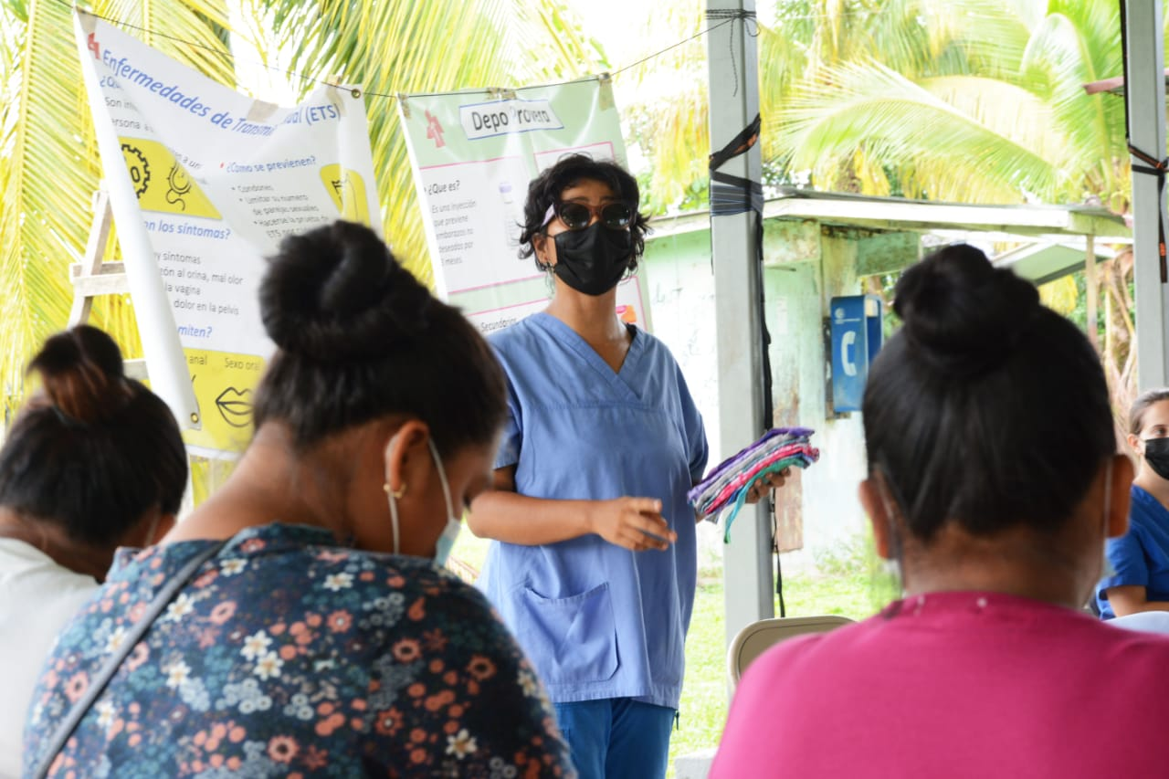 Kelly Hernandez distributing reusable menstral pads to indigenous communities in Bocas del Toro., combatting period poverty in Panama.