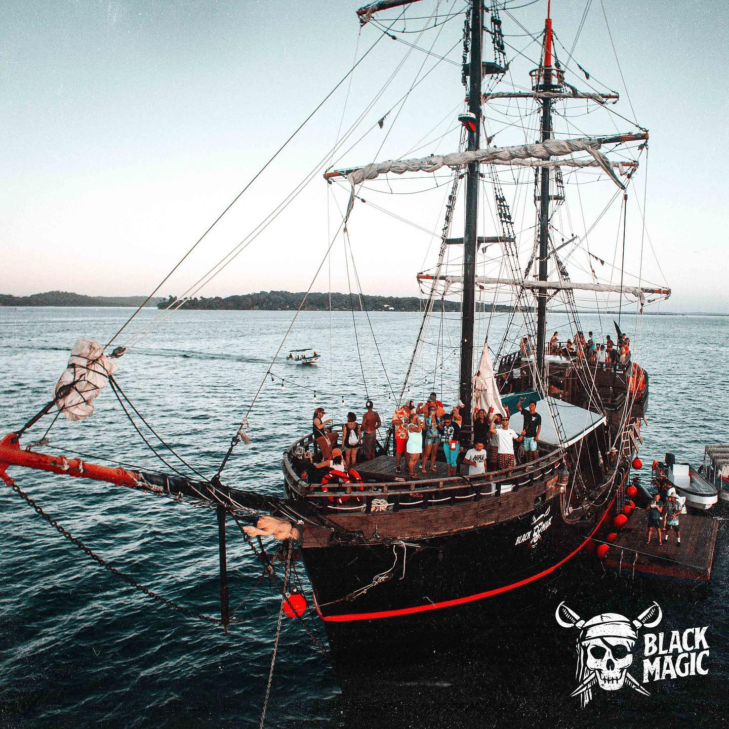 b;lack magic bocas pirate ship in bocas del toro with people hanging out on board