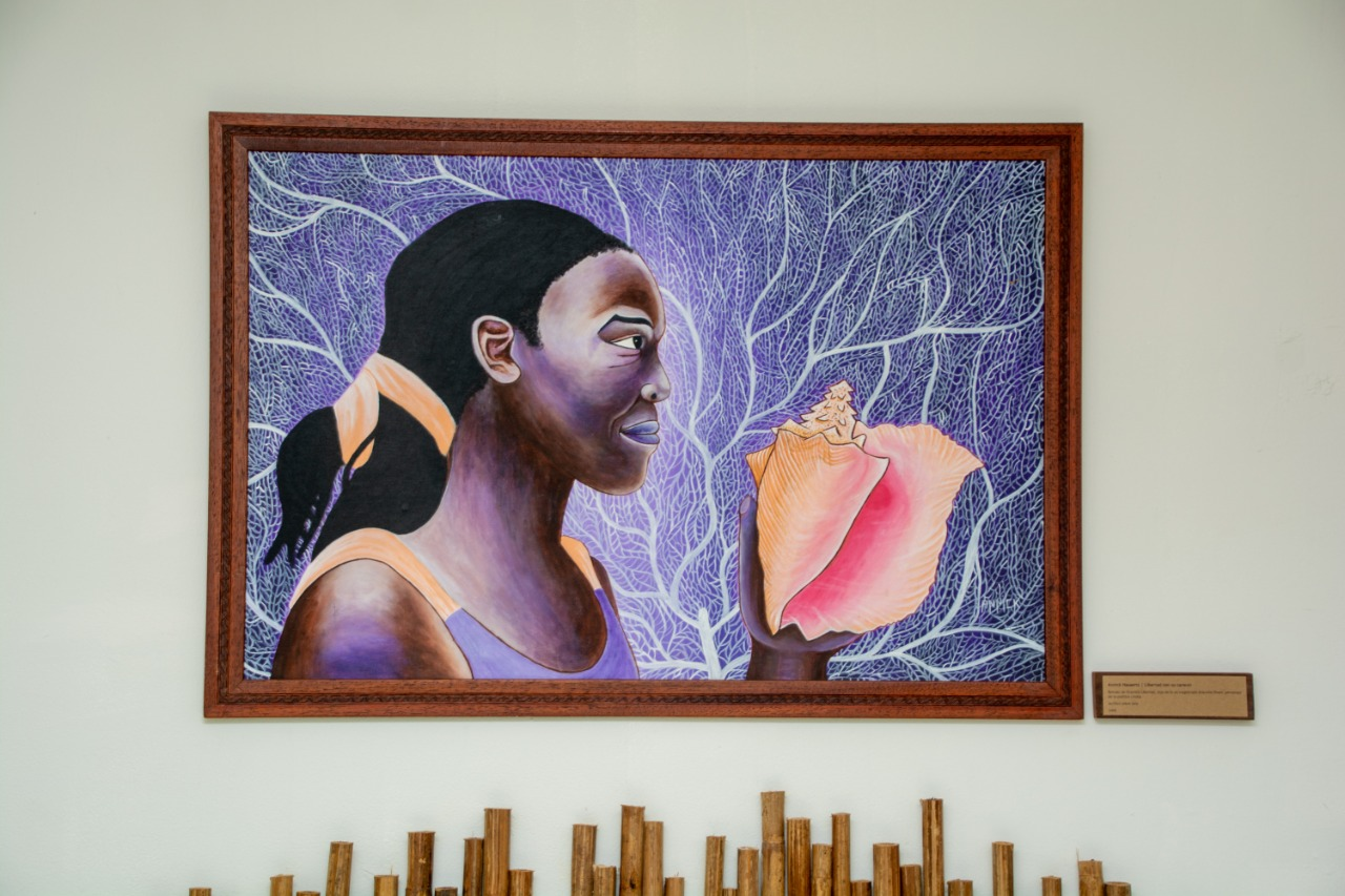a painting of a lady and conch shell as part of the Bocas Forever series