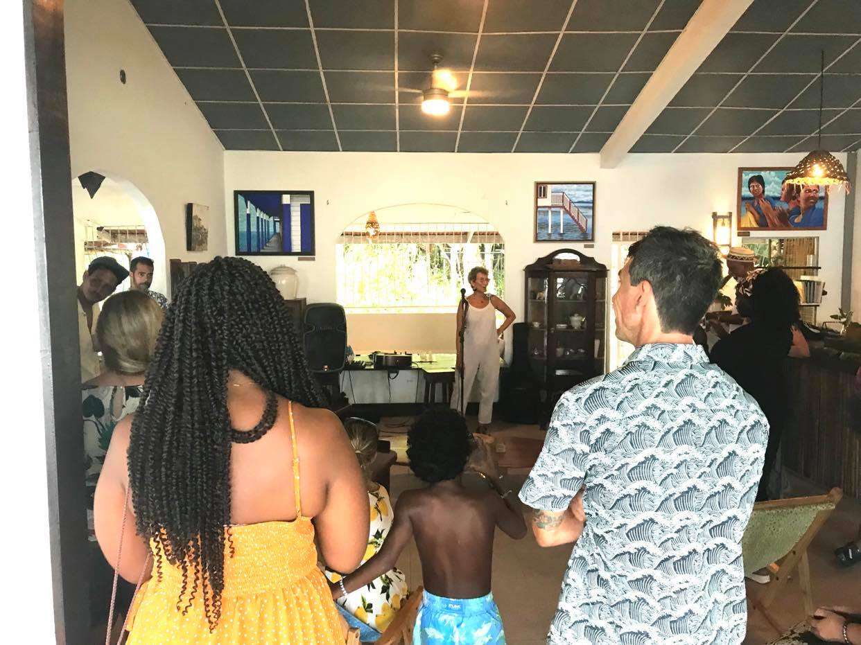 People enjoying the artwork of Annick H. at Bocas Forever
